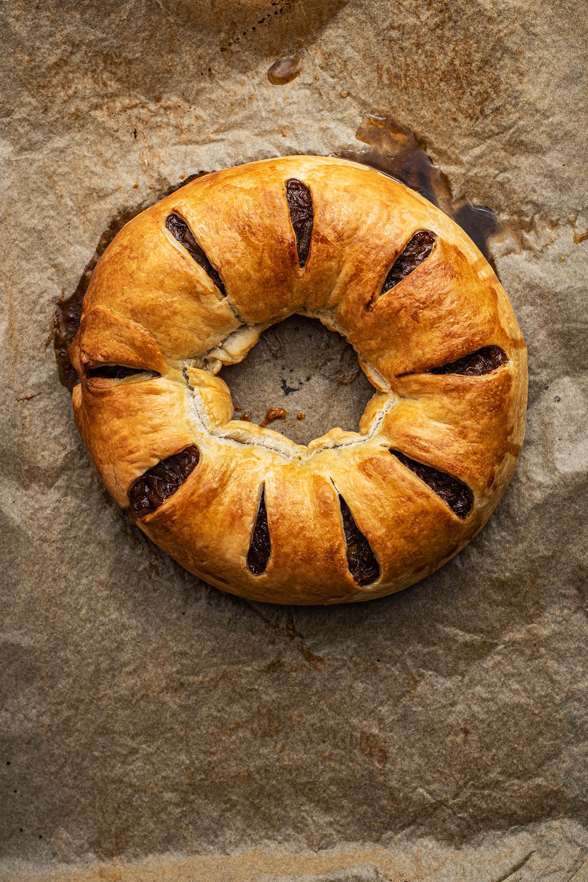 Baked wreath on parchment paper.