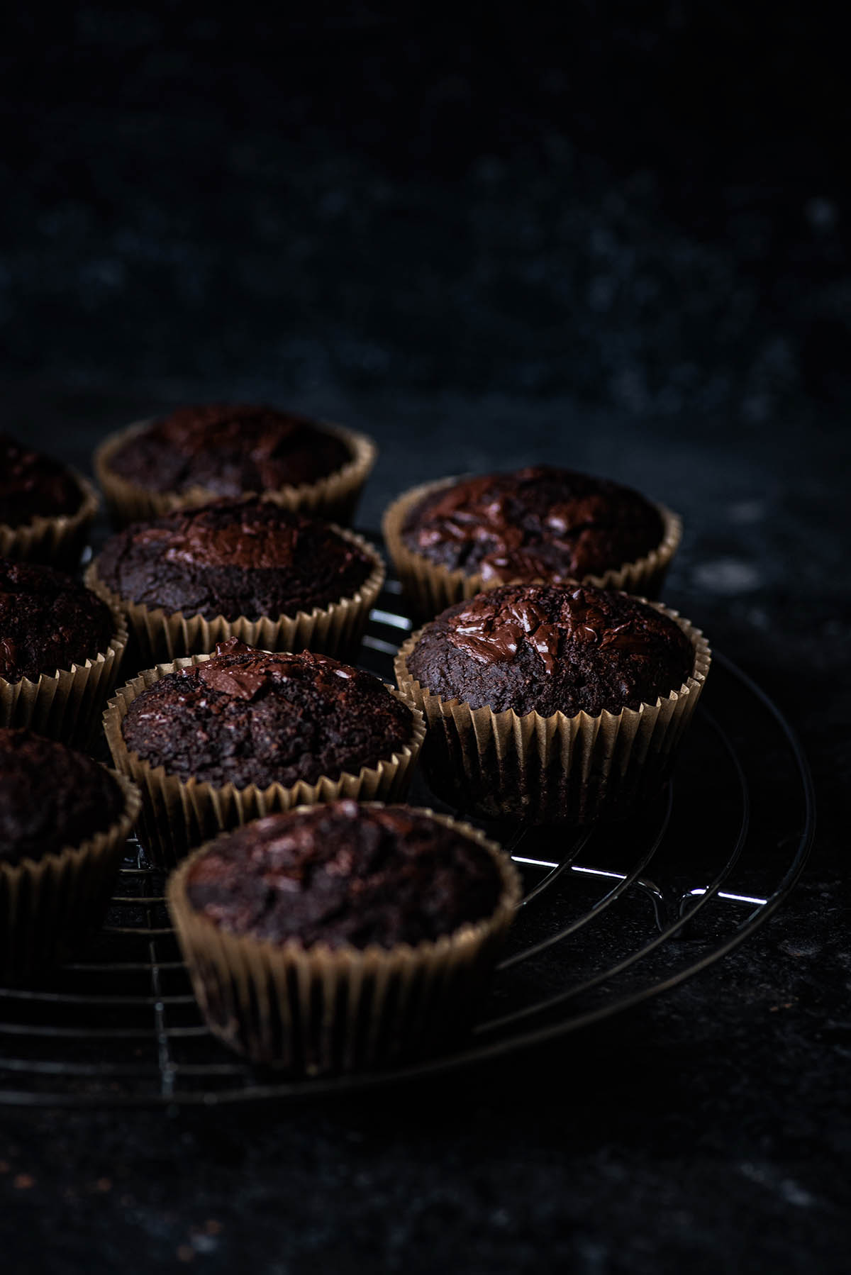 Muffins on a metal cooling rack.