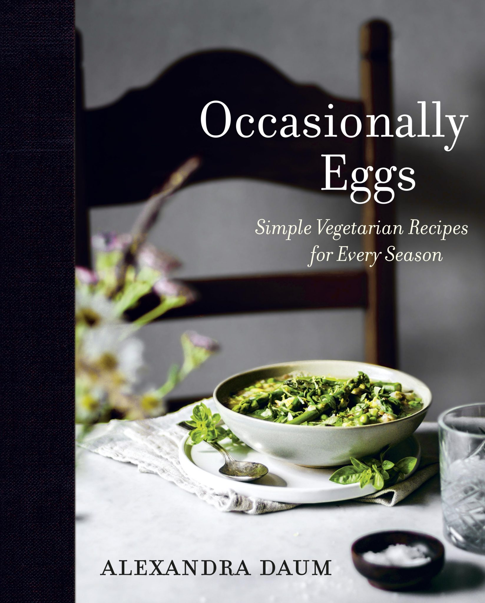 "A cookbook cover with a bowl of soup and writing ""Occasionally Eggs: Simple Vegetarian Recipes for Every Season"" by Alexandra Daum."