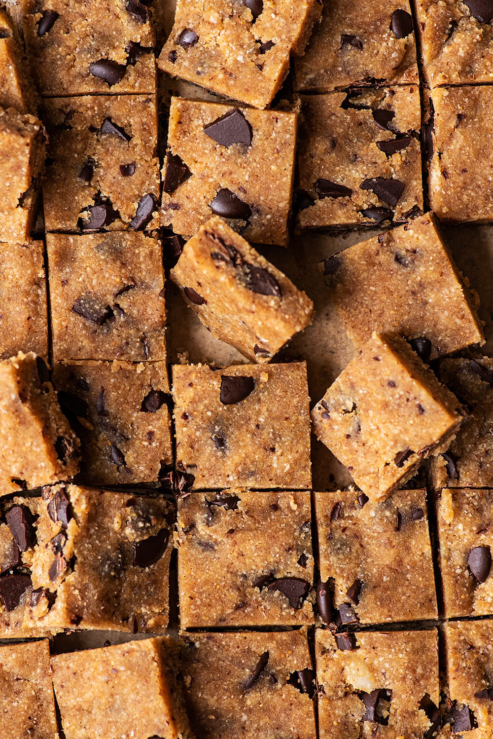 Close up of little cookie dough squares.