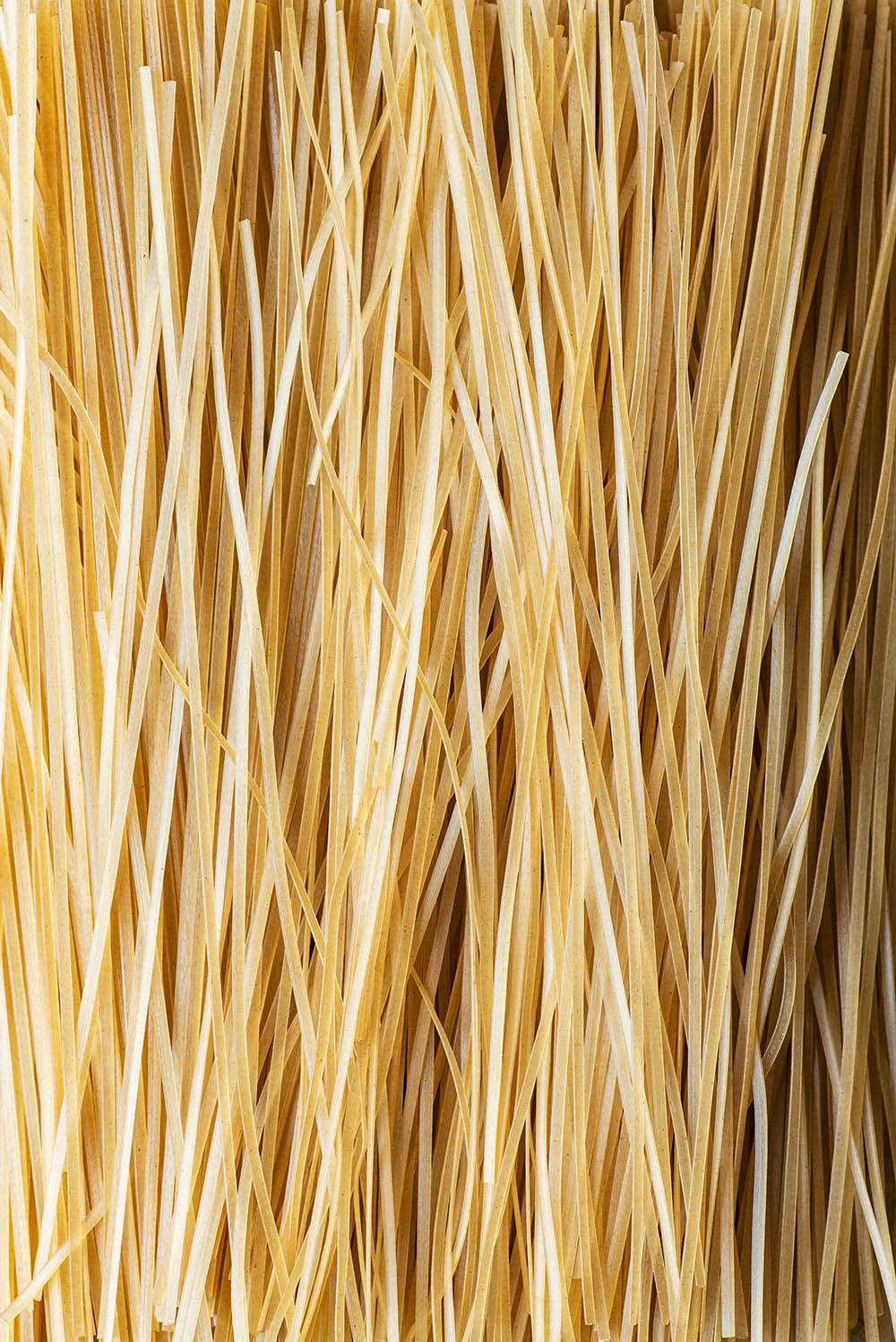 Dry brown rice noodles close up.