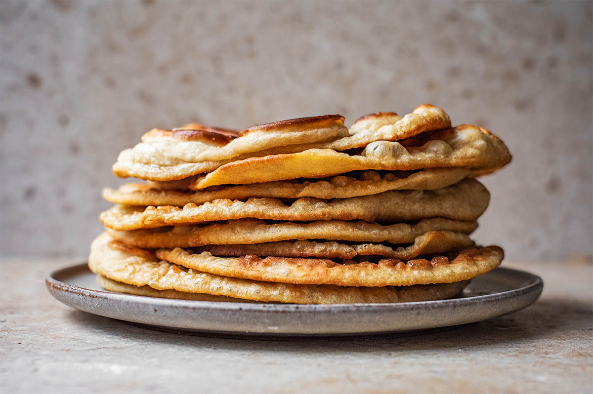 A high stack of flatbreads, front view.