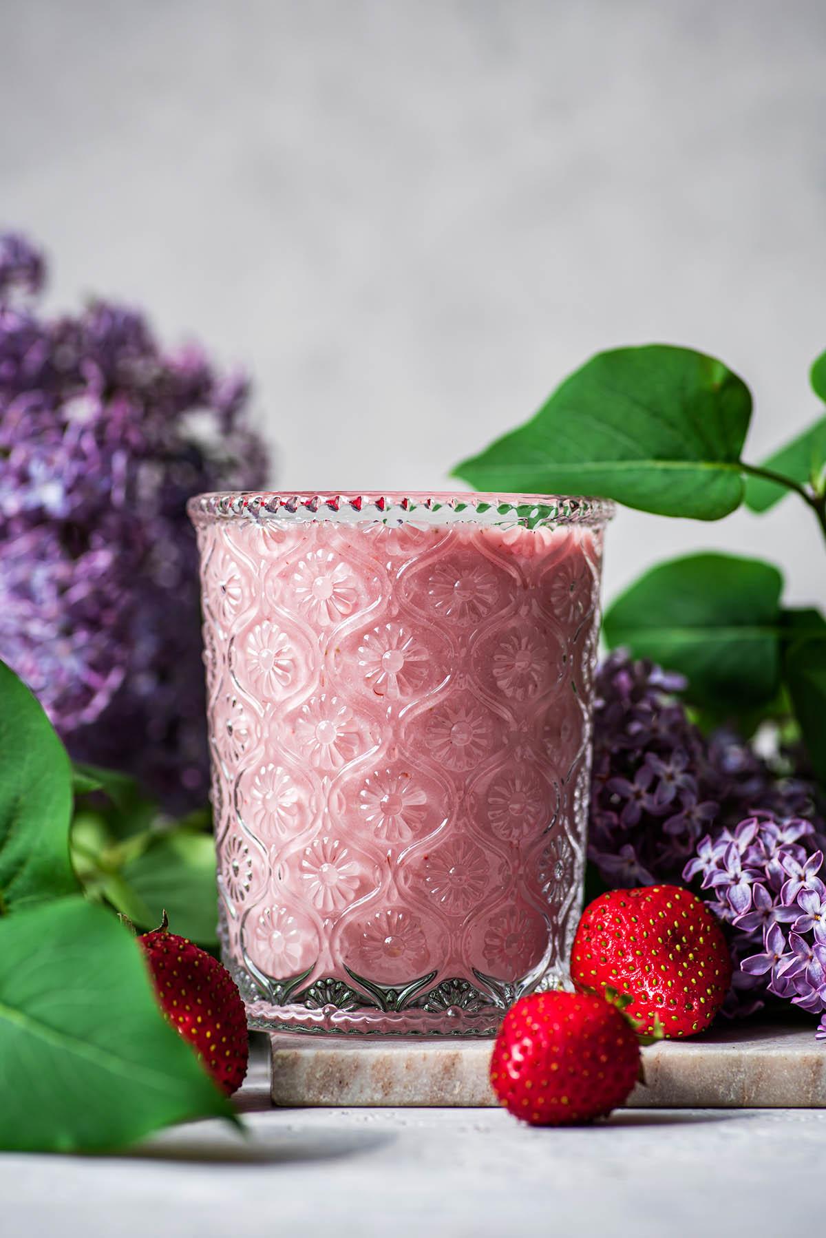 Strawberry milk in a flower glass.