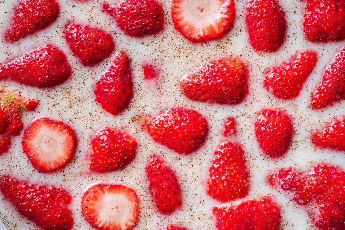 Strawberries floating in milk.