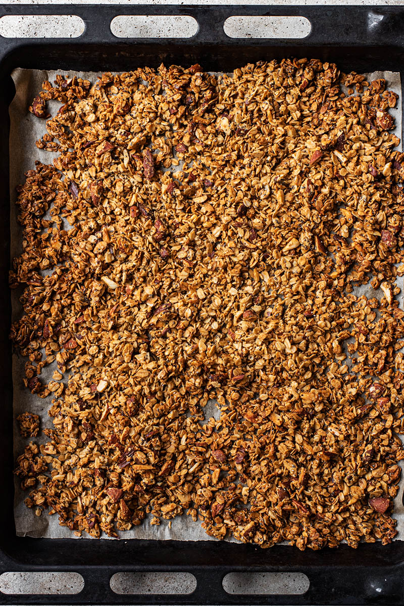 Granola immediately after baking, on the sheet.