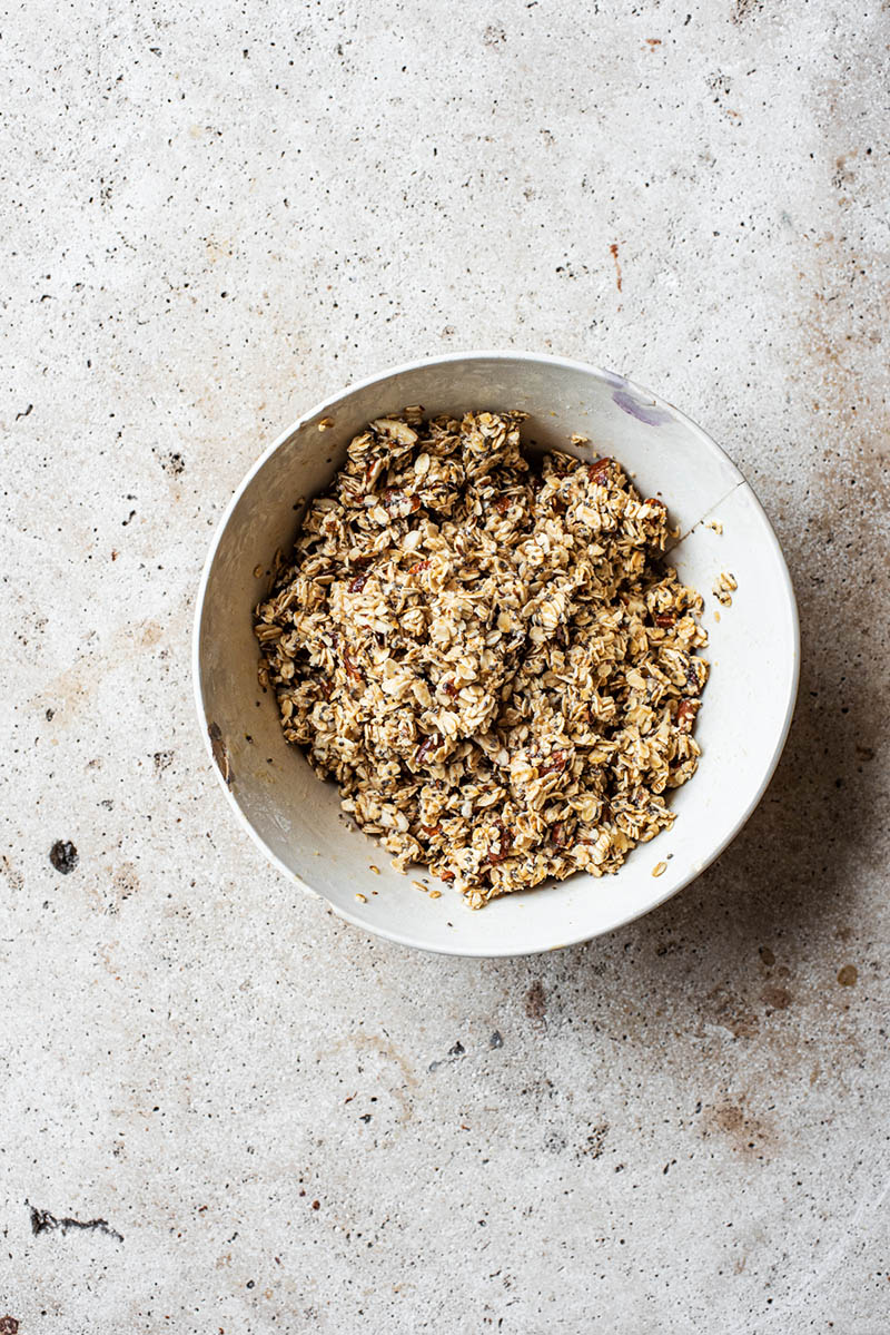 Granola mixture in the large bowl.
