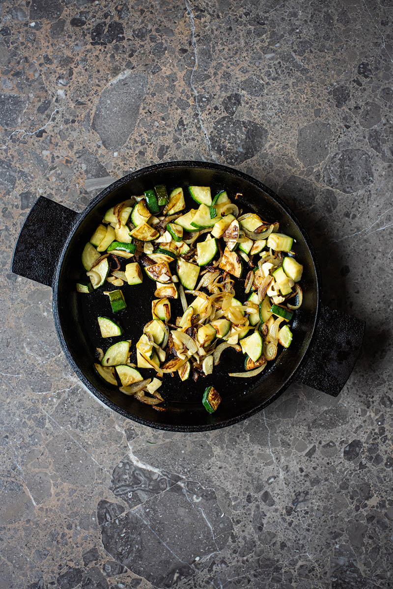 Zucchini, onions, and garlic after cooking in the cast iron pan.