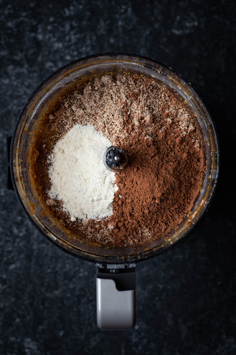 Almond flour, cocoa, and coconut flour added to date mixture.