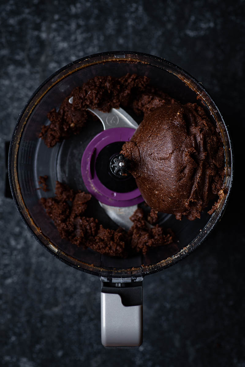Brownie base in the food processor after mixing.