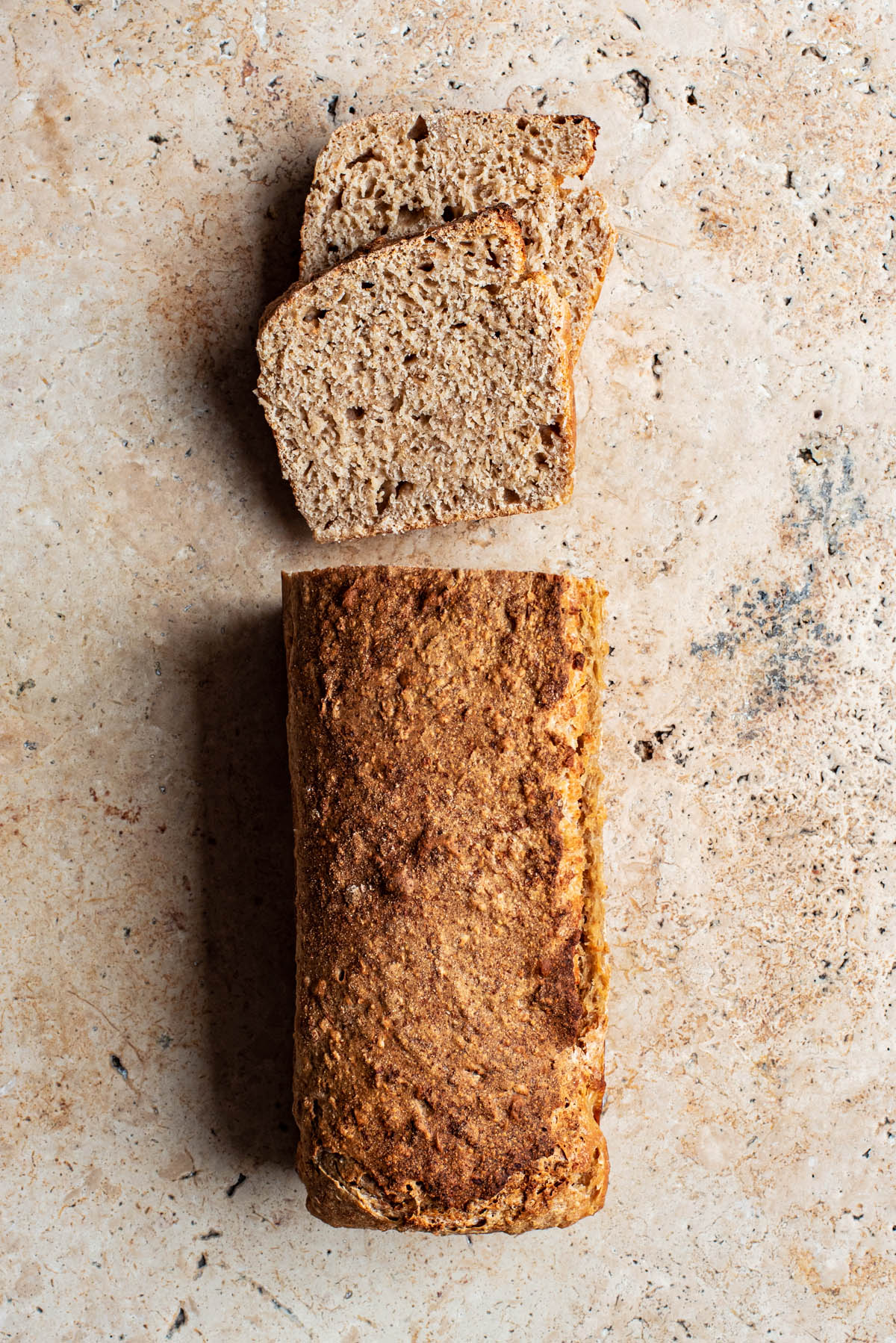 Sandwich bread with two slices cut, top down view.