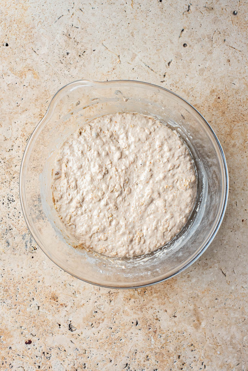 Dough in a large mixing bowl after bulk ferment, doubled in size.