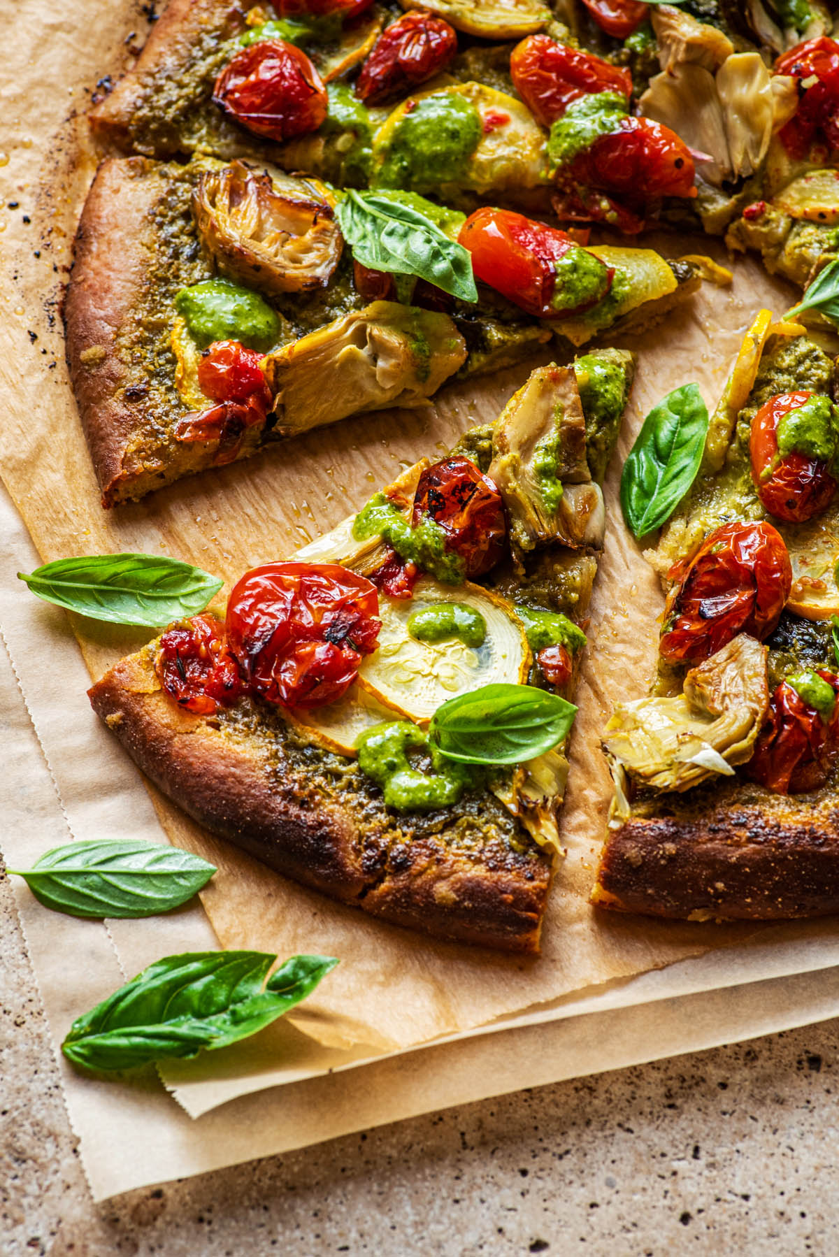 Backlit slices of pizza with fresh basil leaves on them.