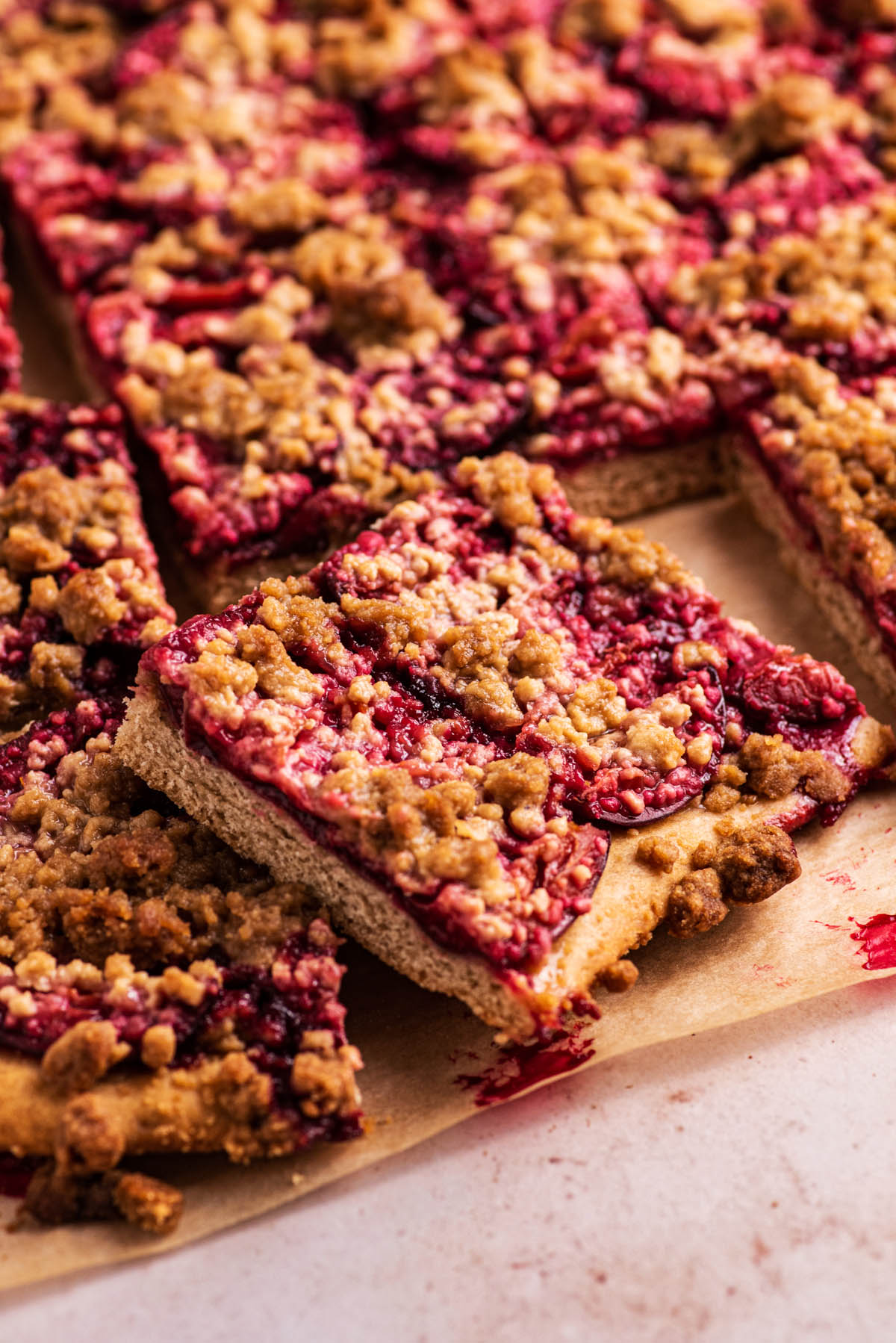 Squares of plum cake, with one propped up on the others.