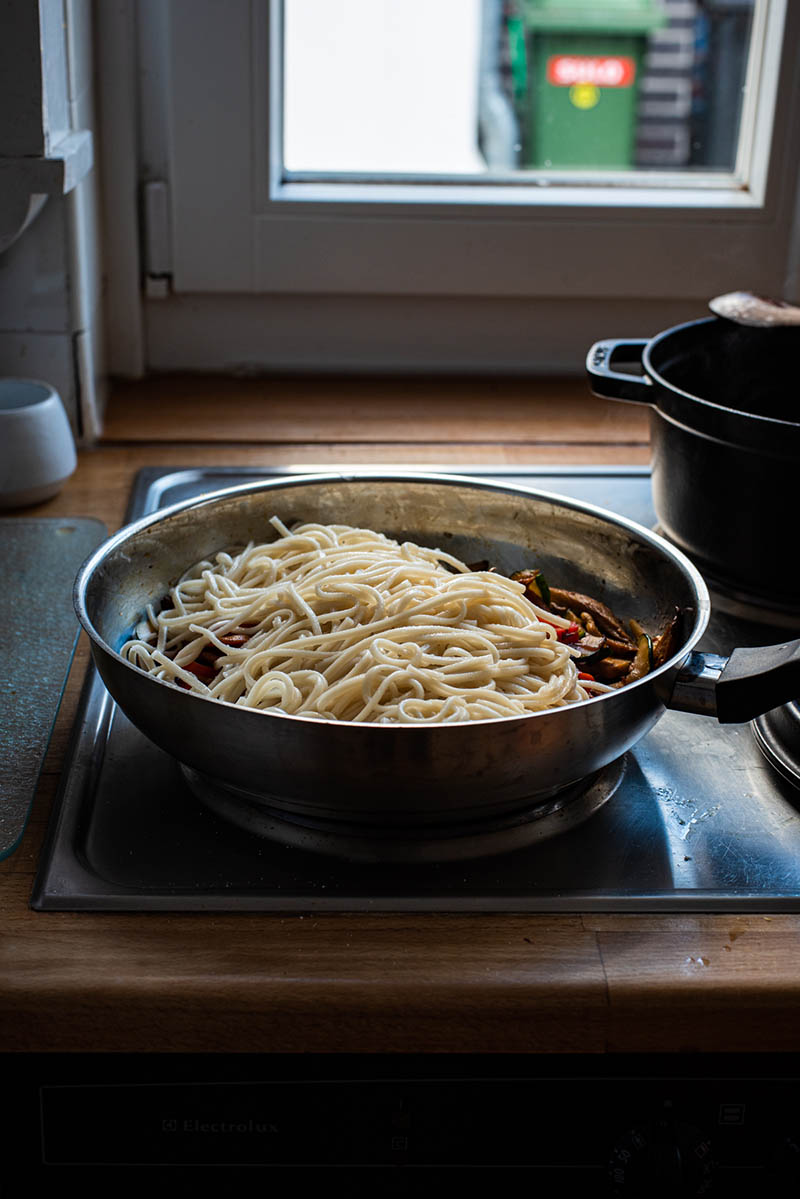 Cooked noodles added to the pan.