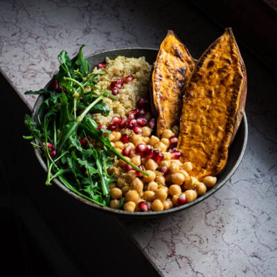 A roasted sweet potato bowl with quinoa, chickpeas, and greens.