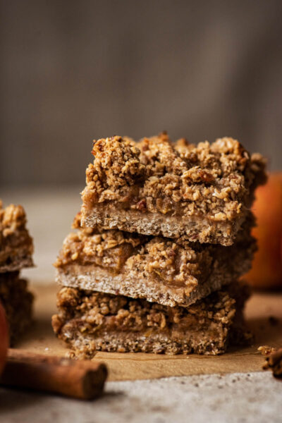 A stack of three bars with cinnamon sticks in foreground.